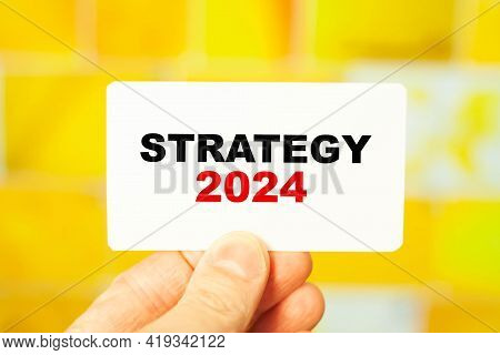A Businessman Is Holding A Business Strategy For 2024. Development Strategy Concept