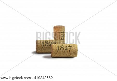 Used Red Wine Corks With Date Isolated On White Background