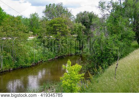 The Manzanares River As It Passes Through A Park In The Community Of Madrid, In Spain. Green Trees O