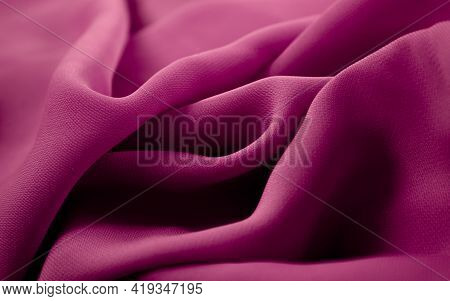 Close-up Texture Of Pink Fabric Or Cloth In Pink Color. Fabric Texture Of Pink Background. Crumpled