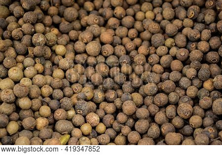 Large Pile Of Allspice Peas. Food Background.