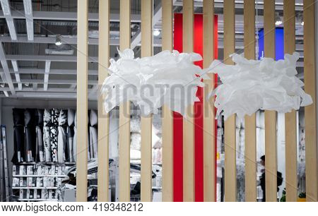 Moscow, Russia, September 2019: Lamps Design Made Of Crumpled Paper In The Shape Of A Flower Or Clou