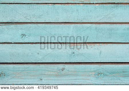 Old Wooden Wall Painted Blue, Weathered Wooden Background With Nails And Slits