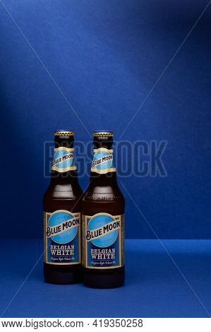 Prague,czech Republic -  8 April, 2021: Two Blue Moon Wheat Beers On The Blue Background. Blue Moon