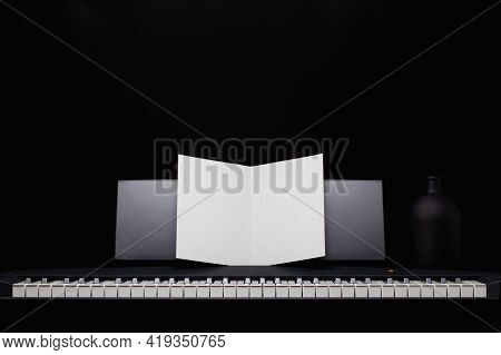 The Silhouette Of Grand Piano In The Dark Room. Piano Keyboard. Music Instrument. Black And White Ke