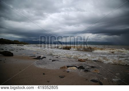 The Waves Of The Sea Of Galilee Crash On The Beach Of, Israel. High Quality Photo