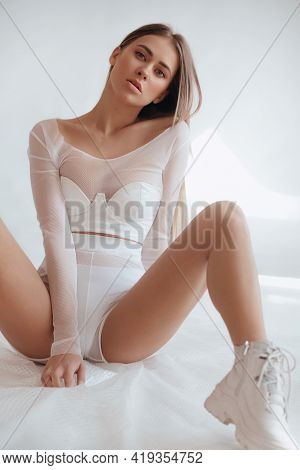 Girl In A Fashionable Color Combination Of Clothes. Total White. Natural Colors. Trend Of 2021. Natu