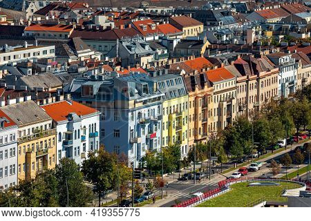 Aerial view of colorful residential buildings and urban road in Vienna, Austria.