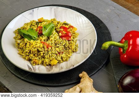 Food For Suhoor In Ramadan Bulgur Post With Vegetables In A Plate On A Gray Background Near Vegetabl