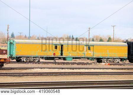 April 26, 2021 In Cheyenne, Wy:  Vintage Rail Car On A Railroad Track At The Rail Yard Taken In Chey