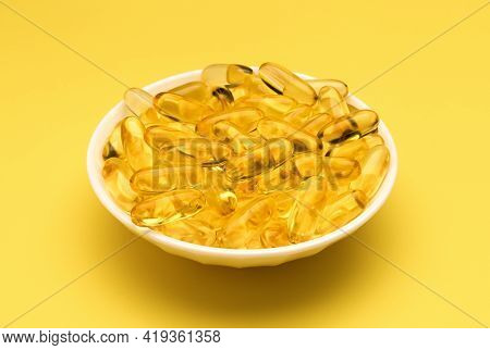 Fish Oil Gel Capsules Isolated In White Dish On White Background. Salmon Fish Capsules View. Omega 3