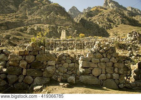 Ancient Ruin Of Kunlyum Village At Autumn In Cherekskoe Gorge, Upper Balkaria, North Caucasus, Russi