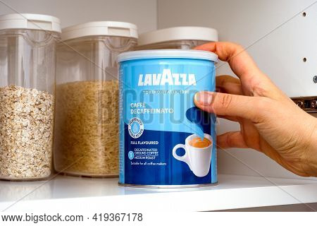 Tambov, Russian Federation - March 19, 2021 Woman Hand Taking Lavazza Decaffeinated Coffee Can Out O