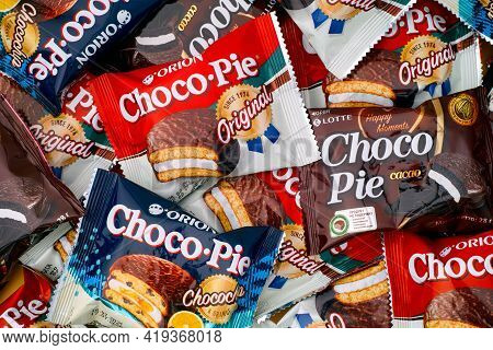 Tambov, Russian Federation - October 30, 2020 Different Tastes Choco-pie Snack Cakes Background. Ful