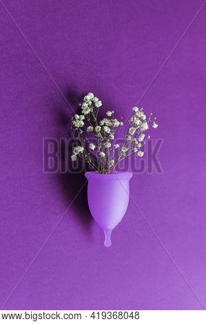 Menstrual Cup With White Flowers On Purple Background Conceptual Feminine Hygiene, Body Care