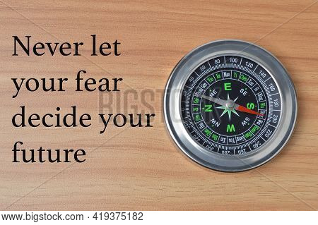 Phrase Never Let Your Fear Decide Your Future. Motivational Quote