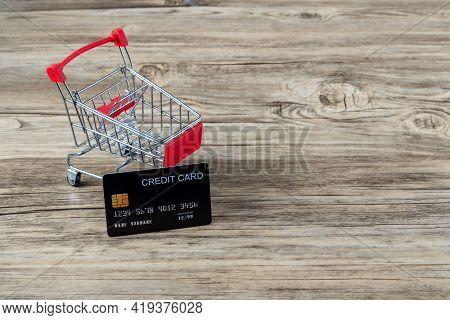 Shopping Cart With Credit Card. Stay Home Shopping And Electronic Payment With Credit Card Concept.