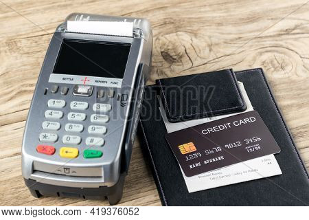 The Black Credit Card On Blank Bill Paper In  Leather Black Bill Receipt. Receipt Holder With Credit