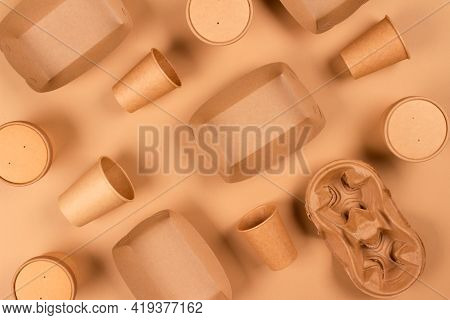 Flat Lay Composition With Eco-friendly Tableware And Kraft Paper Food Packaging On Kraft Paper Backg