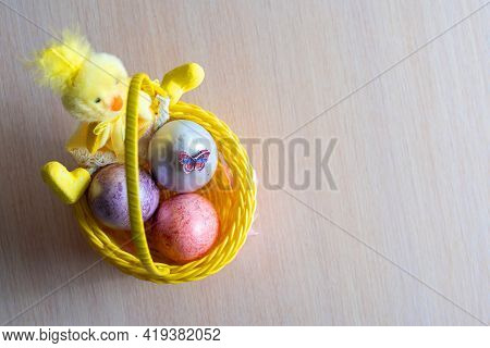 Easter Yellow Fluffy Bunny With Two Easter Chicken Eggs In A Basket. Diy Holiday Background.