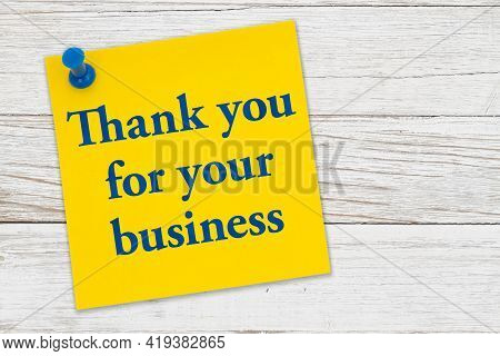Thank You For Your Business Message On A Yellow Sticky Note Paper With Pushpin On Weathered Wood