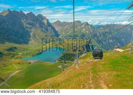 Titlis, Engelberg, Switzerland - Aug 27, 2020: Cable Car On Engelberg Valley With Truebsee Lake. Cab