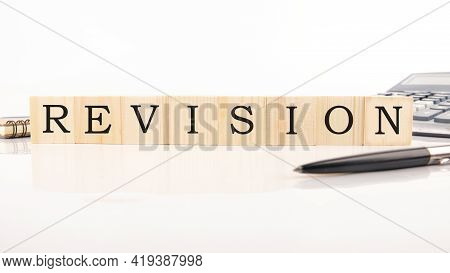 Text Revise From Wooden Letterson On White Background