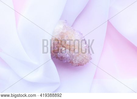 Beautiful Pink Crystals Of Amethyst Quartz On White Transparent Fabric. Cactus Quartz, Known As Spir