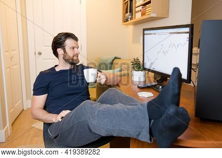 Man Looking At Finance Chart On Computer, Day Trader, Investing From Home, Sipping Coffee, Relaxed M