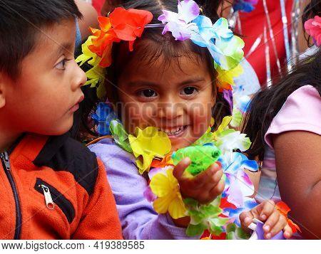 Cuenca, Ecuador - February 22, 2020: Carnival In Cuenca. Little Smiling Girl Dressed In Carnival Cos
