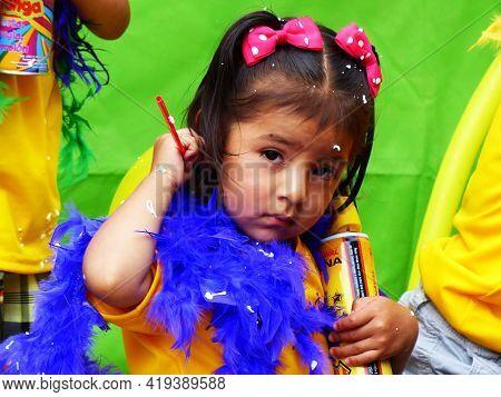 Cuenca, Ecuador - February 22, 2020: Carnival In Cuenca. Little Girl Dressed In Carnival Costume Wit