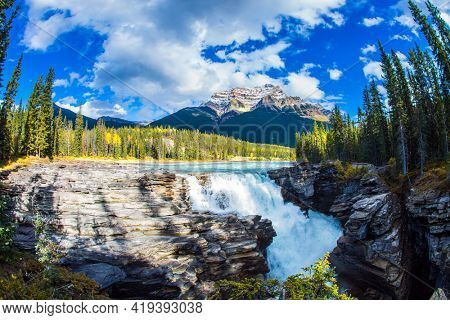 The famous Athabasca Falls. Mountain, river and waterfall make up magnificent landscapes. Rocky Mountains of Canada. Jasper Park. Travel and ecological tourism concept