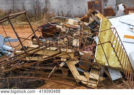 Storage Of A Pile Of Different Industrial Debris And Waste In The Open Area Of The Construction Site