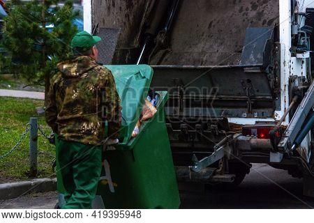 Garbage Man Collecting Household Waste, Close Up
