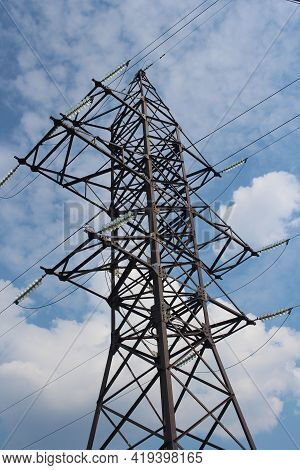 Electric Wire Tower Metal Support With High Voltage Voltage Volts On The Sky Background