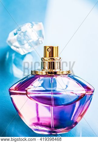 Perfume Bottle On Glossy Background, Sweet Floral Scent, Glamour Fragrance And Eau De Parfum As Holi