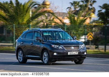 Alanya, Turkey  - April 17  2021: Black Lexus Rx Is Driving Fast On The Street On A Warm Summer Day