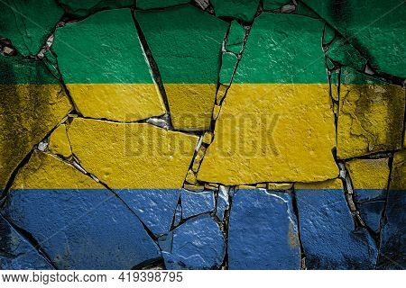 National Flag Of Gabon  Depicting In Paint Colors On An Old Stone Wall. Flag  Banner On Broken  Wall