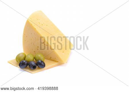 A Piece Of Hard Yellow Gouda Cheese With Olives Close-up, Isolated On A White Background.selective F