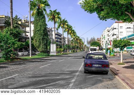Alanya, Turkey - October 23, 2020: Rear View Of A Car Parked At The Sidewalk On Ataturk Boulevard In
