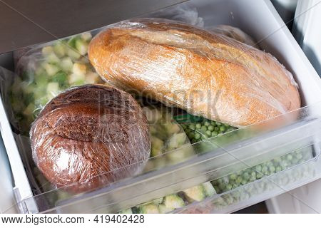 Frozen Bread In The Home Freezer. The Frozen Products. Long Life Food Storage Concept.