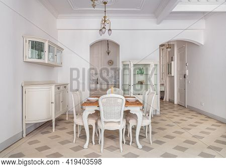 Interior Of Dining Room With A Table Served For Two Persons. Refurbished Apartment In Barcelona Deco