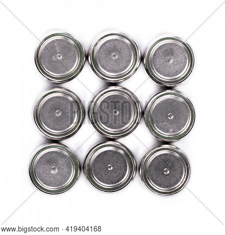 Group of button cell isolated on white background. Small watch lithium batteries