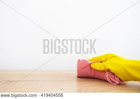 Furniture Cleaning. Detergent Product. Careful Room Hygiene. Unrecognizable Person Using Wiping Dust