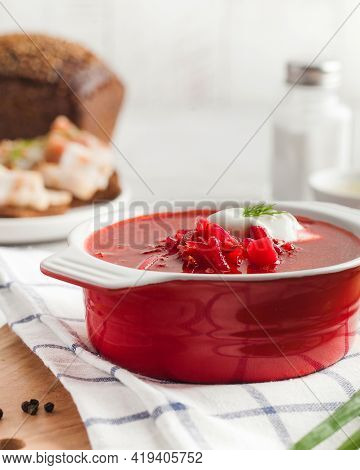 Delicious Fresh Red Borscht, Dark Bread With Lard And Salt N Kitchen Table.