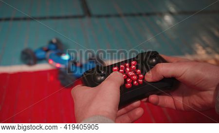 Photo Of Man With Radio Controlled Car And Keypad