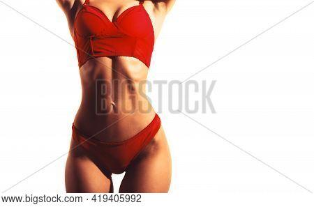 Sensual Waist. Sexy Woman In Elegant Red Underwear. Athletic Body, Slim Waist, Sexy Girl. Sexy Young
