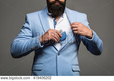 Man Perfume, Fragrance. Masculine Perfume, Bearded Man In A Suit. Male Holding Up Bottle Of Perfume.