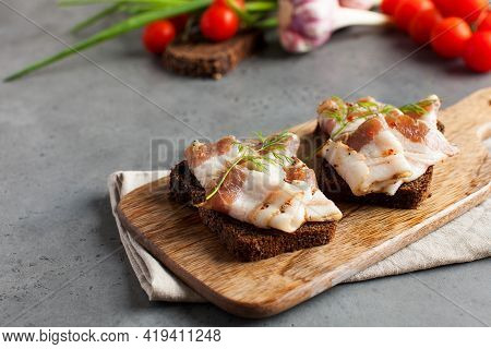 Two Bread Slices With Salted Pork Bacon Or Lard, Traditional Snacks To Ukrainian Borscht
