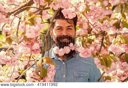 Hiding In Bloom. Handsome Bearded Man Outdoors. Happy Easter. Weekend In Garden Concept. Lot Of Flow